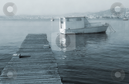 IsleDeMarguerite #33 stock photo, Old fishing boat next to the pier of Ile Sante-Marguerite  by Sean Nel