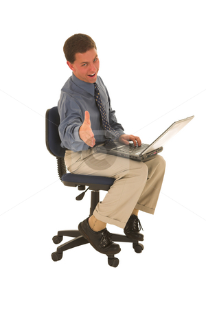 Businessman #49 stock photo, Man sitting on chair working on laptop. by Sean Nel