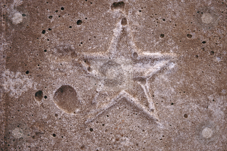 Cement star stock photo, Embossed star in concrete by Sean Nel