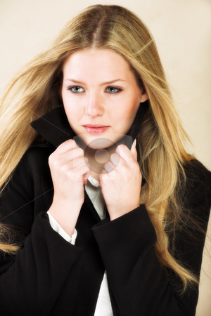 Young adult woman stock photo, Portrait of a beautiful young adult Caucasian woman with light skin and straight blond hair, green eyes and red lips, wearing a white shirt and black flannel winter coat by Sean Nel