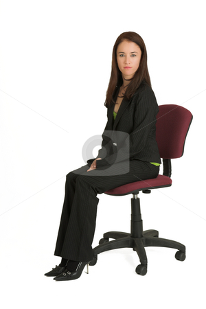 Business Woman 539 stock photo, Portrait of a brunette business woman, sitting on an office chair.  Looking serious. by Sean Nel
