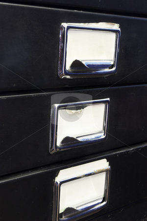 Filing cabinet #3 stock photo, Close-up of a black mini filing cabinet and label with three closed drawers by Sean Nel