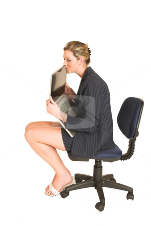 Laura Hopton #1 stock photo, Business woman on office chair with Laptop - kissing laptop by Sean Nel