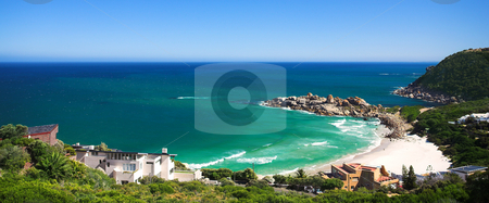 Llandudno beach in a secluded cove stock photo, Llandudno beach and popular surf spot in the Western Cape of South Africa. Rather large and secluded beach with shallow water and a blue sky with copy space by Sean Nel
