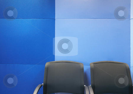Office chairs against blue wall