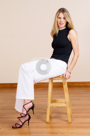 Woman #17 stock photo, Beatiful blonde woman sitting on a barstool by Sean Nel