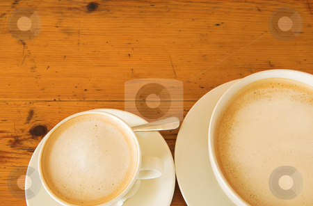 Lunch #28 stock photo, Two cups of coffee on a wooden table by Sean Nel