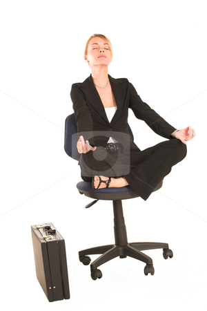 Businesswoman #258 stock photo, Blonde business lady in formal black suit. Meditating on an office chair. by Sean Nel
