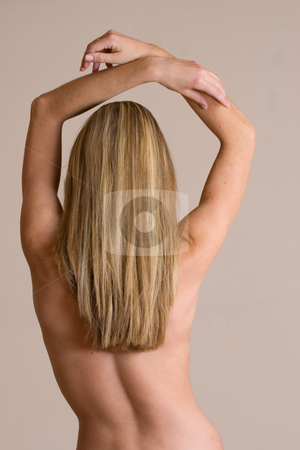 Cdtorso #1 stock photo, Naked blonde woman from behind - arms lifted by Sean Nel