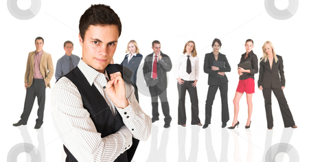 Formal businessman standing in front of a business people group stock photo, Formal businessman wearing a pinstripe suit, standing in front of a group of business people all isolated on white. The whole group consists of multiracial young adults. The foreground is in sharp focus with the people in the background slightly blurred. by Sean Nel