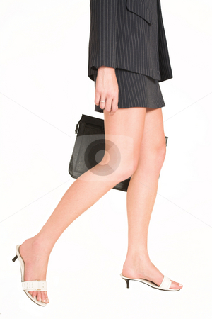 Laura Hopton #19 stock photo, Business woman walking, holding a leather suitcase - movement on right leg by Sean Nel