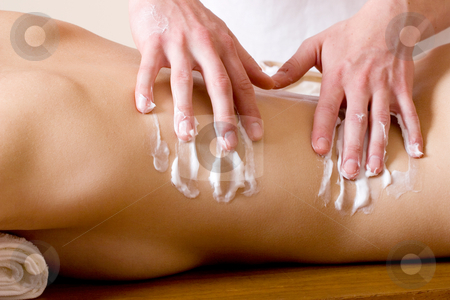 Massage #20 stock photo, Woman lying on massage table with the hands of male masseuse on her back by Sean Nel