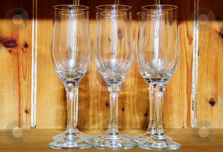 Glass stock photo, 6 Champagne glasses, in front of a wooden pannel by Sean Nel