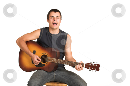 Franscois Booysen #13 stock photo, Young man with guitar. Sitting on wooden chair, singing - copy space by Sean Nel
