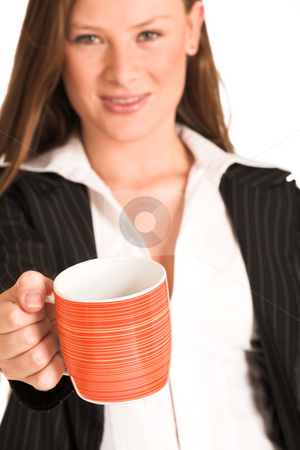 Business Woman #216(GS) stock photo, Business woman dressed in a pinstripe suite, holding an orange mug.  Shallow DOF - mug in focus, face out of focus. by Sean Nel