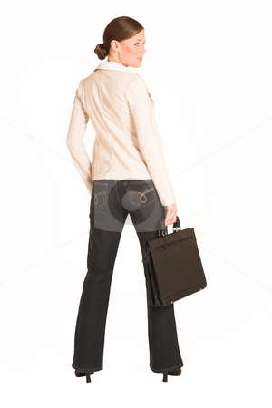 Business Woman #220(GS) stock photo, Business woman dressed in jeans and a beige jacket.  Holding a leather suitcase by Sean Nel