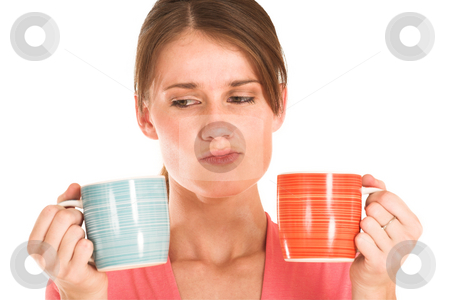 Business Woman #432 stock photo, Brunette business woman in  an informal light pink shirt.  Holding two mugs, looking confused. by Sean Nel