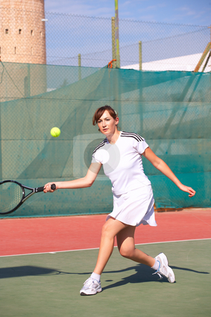Female Tennis Players stock photo, Young women playing tennis in the sun - movement on edges by Sean Nel