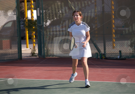 Female Tennis Player stock photo, Young woman playing tennis in the sun by Sean Nel