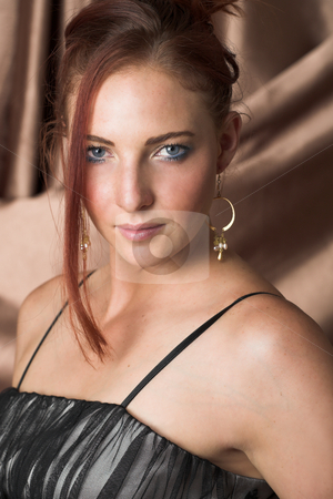 Sexy adult woman stock photo, Beautiful young sexy adult Redheaded woman with long auburn hair, in formal black dress on a textured silk background ? Hard light, high key by Sean Nel