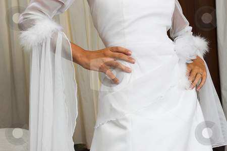 Bridal gown stock photo, Bride with hands on hips by Sean Nel
