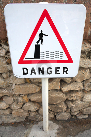Danger Sign 01 stock photo, Danger sign next to the sea by Sean Nel