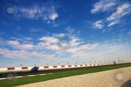 Lusail Race Track stock photo, Section of astro turf and asphalt next to the Lusail GP and race track. Main straight grandstand and pavilion by Sean Nel