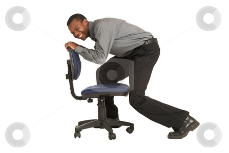 Businessman #148 stock photo, Businessman riding on an office chair.  Movement - face out of focus, chair in focus. by Sean Nel