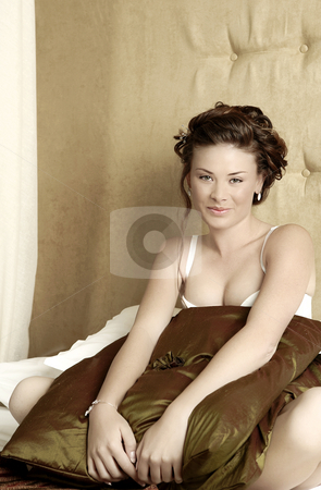 Lingerie#239 stock photo, Woman in underwear sitting on a bed. by Sean Nel