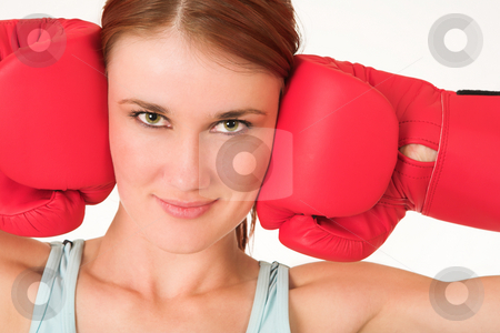 Gym #25 stock photo, A woman in gym clothes, wearing red boxing gloves. by Sean Nel