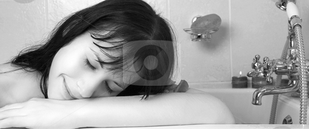Woman #104 stock photo, Nude woman in a bath.  black and white. by Sean Nel