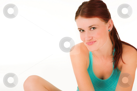 Gym #21 stock photo, A woman in gym clothes, stretching by Sean Nel