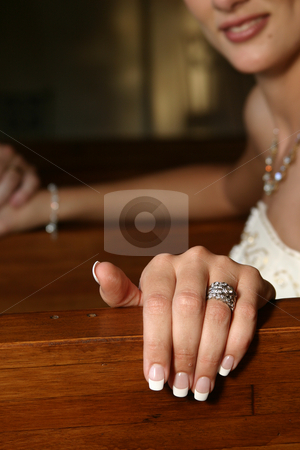 Hand and ring stock photo, Bride with brand new wedding ring by Sean Nel