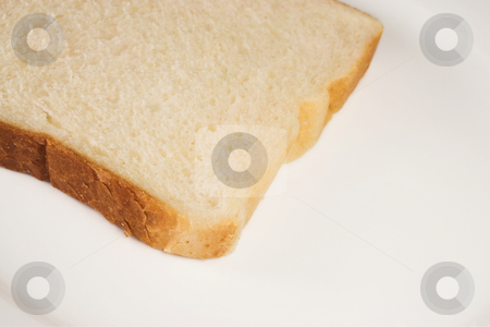 Food #43 stock photo, A slice of white bread on a white plate. by Sean Nel