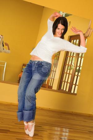 Modern Ballet Dancer on pointe  stock photo, Modern Ballet Dancer in blue jeans and Pointe Shoes. Practicing in Studio by Sean Nel
