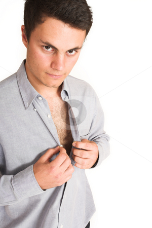 Businessman #106 stock photo, Businessman unbottoning his shirt. by Sean Nel