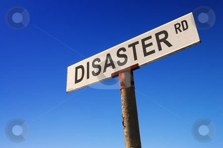 Sign against blue sky stock photo, Weathered old road sign against a clear blue sky - Concept image: Road to DISASTER by Sean Nel