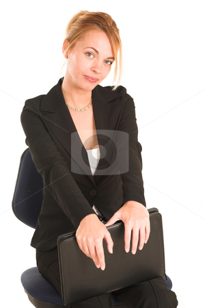 Businesswoman #261 stock photo, Blonde business lady in formal black suit. Sitting on an office chair, holding a file by Sean Nel