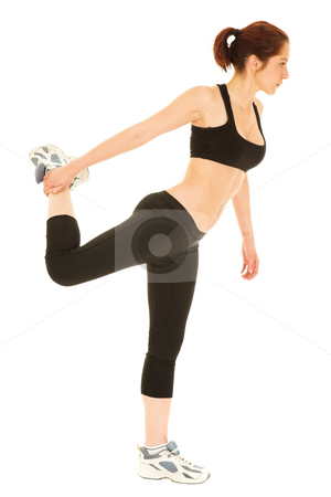 Woman in black tracksuit stretching stock photo, Isolated young adult Caucasian woman doing stretches by Sean Nel