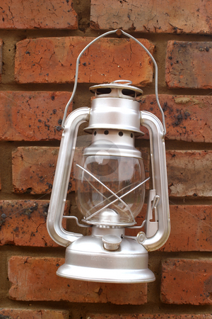 Silver storm lantern stock photo, Tin Storm lantern by Sean Nel
