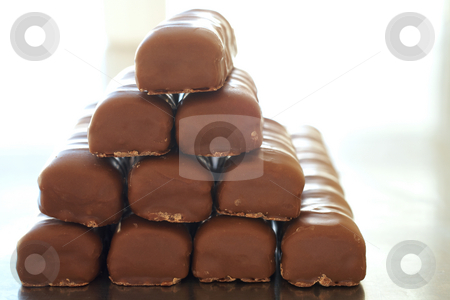 Chocolate bar tower stock photo, Tower of thin chocolate bars by Sean Nel