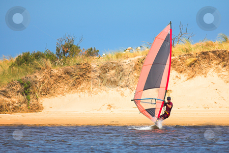 Fast moving windsurfer  stock photo, Fast moving windsurfer on the water at Keurbooms Lagoon, South Africa  by Sean Nel
