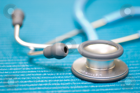 Medical Equipment #1 stock photo, Lightweight medical Stethoscope on blue examination matt - Shallow DOF by Sean Nel