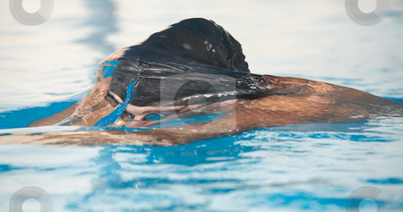 Young adult swimmer stock photo, Healthy young adult male aquatic athlete. Professional swimmer in blue water by Sean Nel