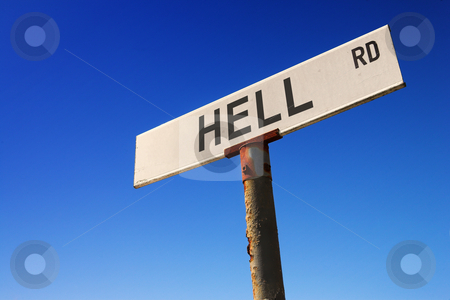 Sign against blue sky stock photo, Weathered old road sign against a clear blue sky - Concept image: Road to HELL by Sean Nel