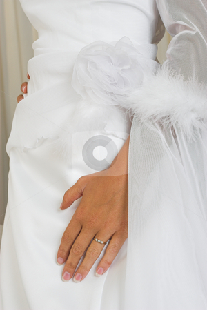 Hand on wedding gown stock photo, Hand with ring on wedding gown by Sean Nel