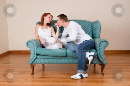 Trudy-Lee & Tommy #4 stock photo, Woman and boyfriend sitting on couch by Sean Nel