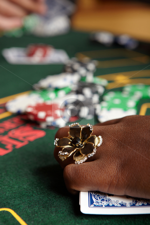 Card gambling stock photo, Playing cards, chips and players gambling around a green felt poker table. Shallow Depth of field by Sean Nel