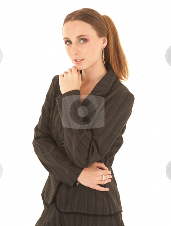 Sexy brunette businesswoman stock photo, Sexy young adult Caucasian businesswoman in a black sexy business suit on a white background. She has modern make-up on her eyes by Sean Nel