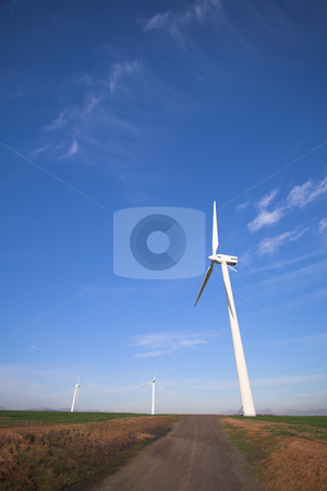 Wind powered turbine stock photo, Wind powered electricity turbine in the green field on wind farm at sunset by Sean Nel